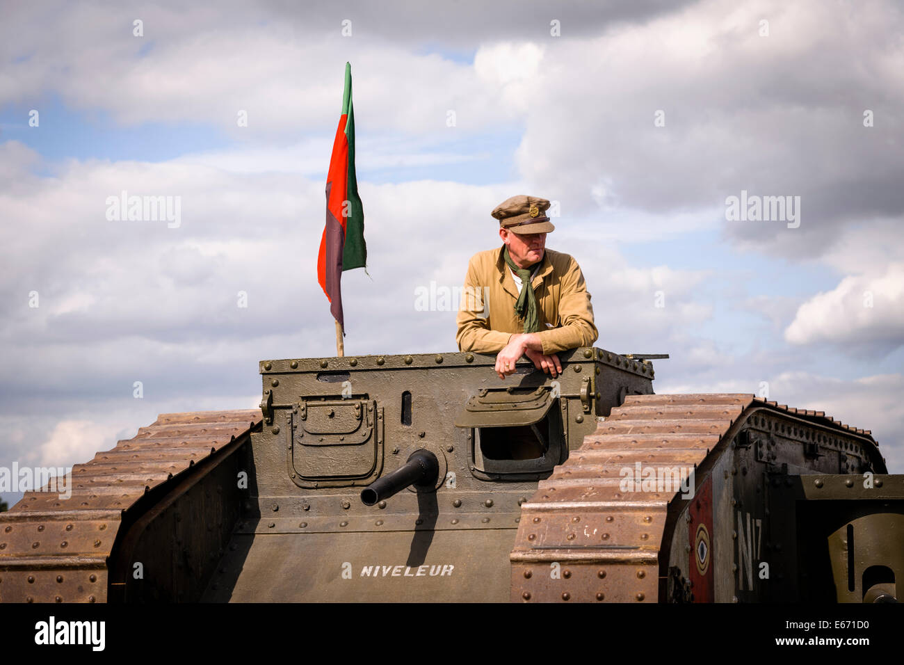 Posing in a N17 Niveleur WW1 Mk lV Tank at The 6th Annual Combined Ops Show at Headcorn Airfield. Featuring fly - Stock Image