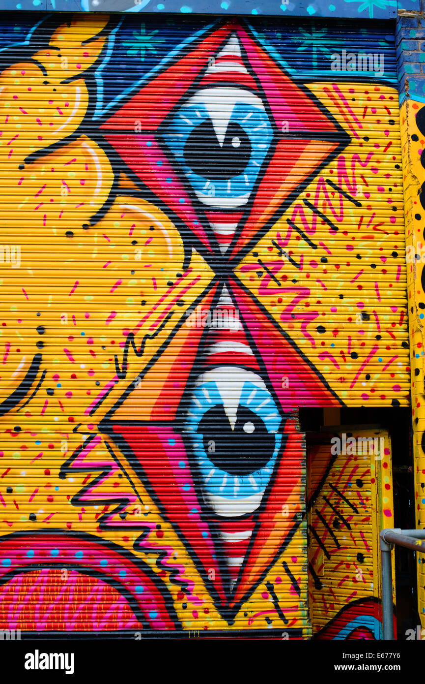 Hackney Wick. Street Art with giant eyes on the side of a building - Stock Image