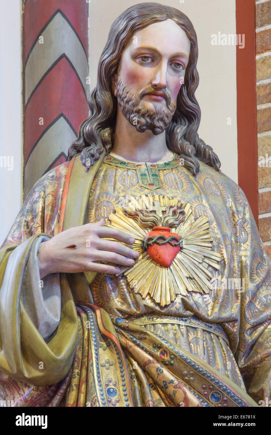 BRUGES, BELGIUM - JUNE 13, 2014: The heart of Jesus statue in st. Giles church (Sint Gilliskerk) - Stock Image