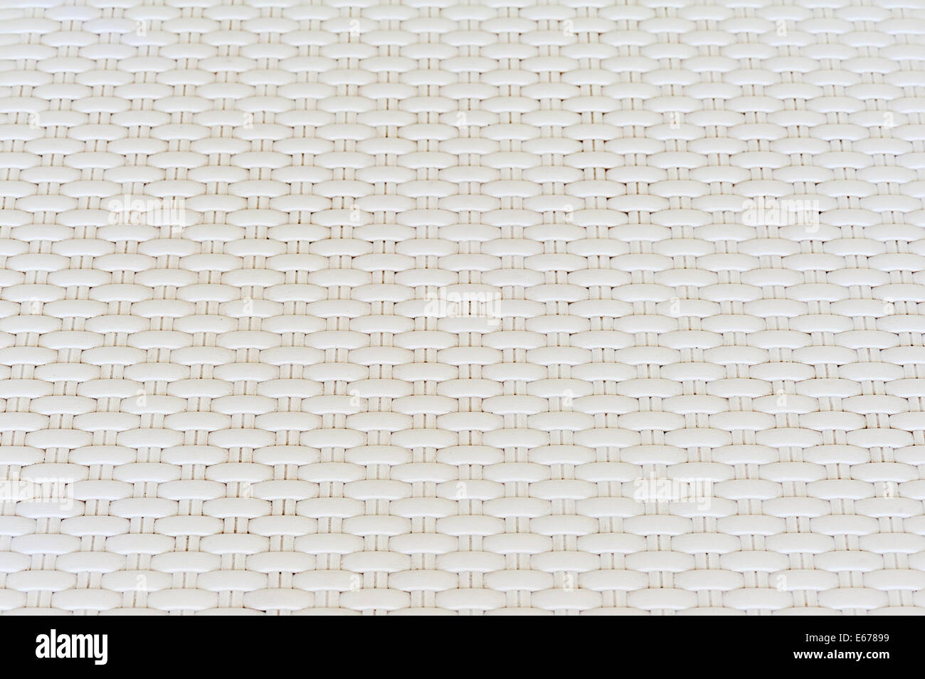 White cream plastic surface with repeating pattern. For use as background. Stock Photo