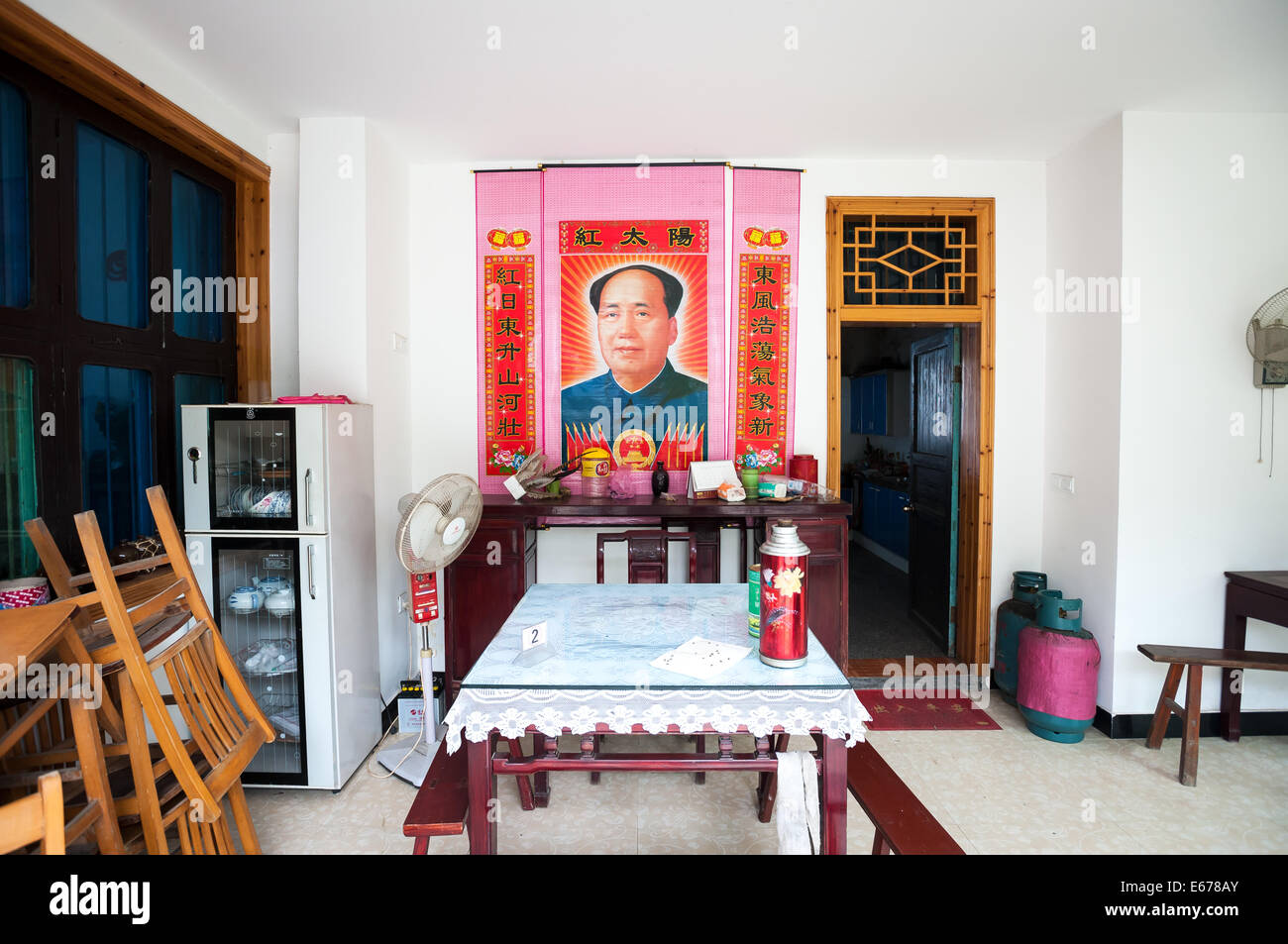 Chairman Mao poster inside a Chinese dining room - Stock Image