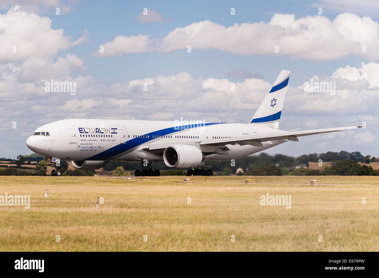 A Boeing 777 (4X-ECF)— EL AL Israel Airlines taking off from Luton Airport in England , Britain , Uk - Stock Image