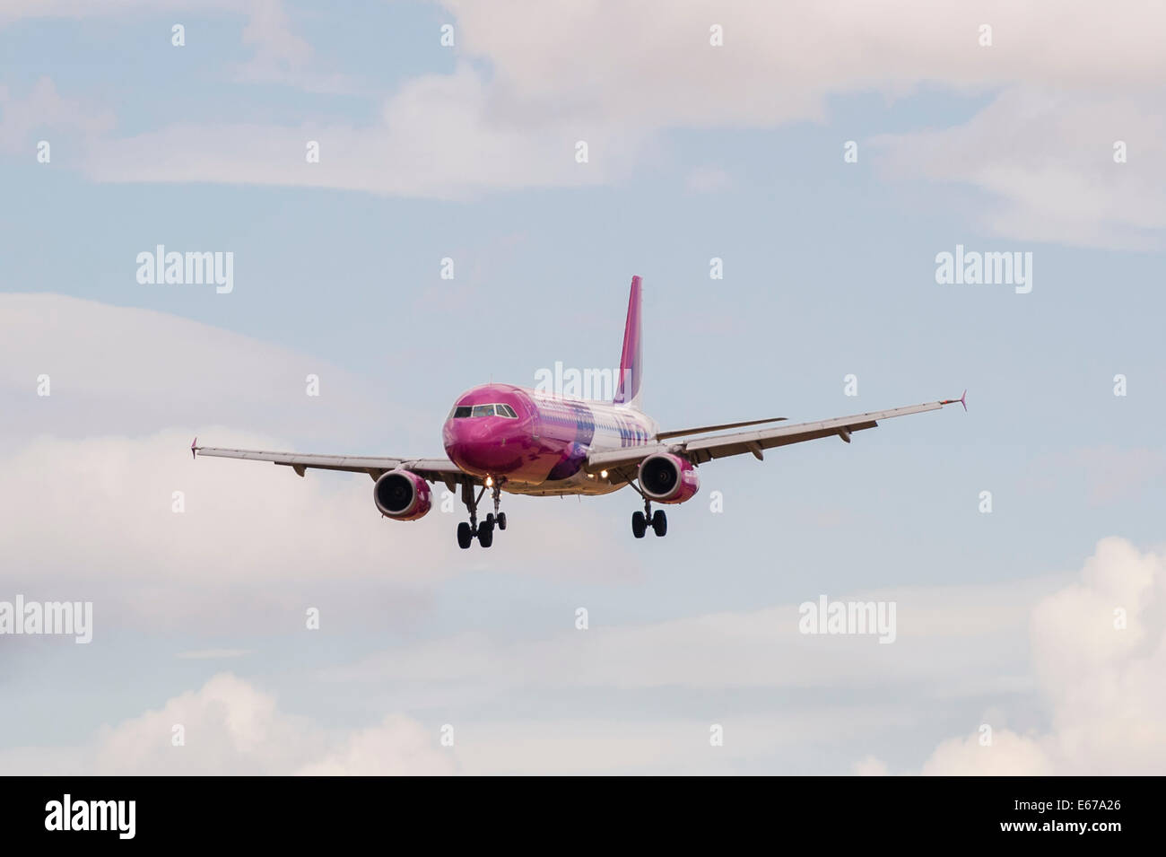 A Wizzair Airbus A320 landing at Luton Airport in England , Britain , Uk - Stock Image