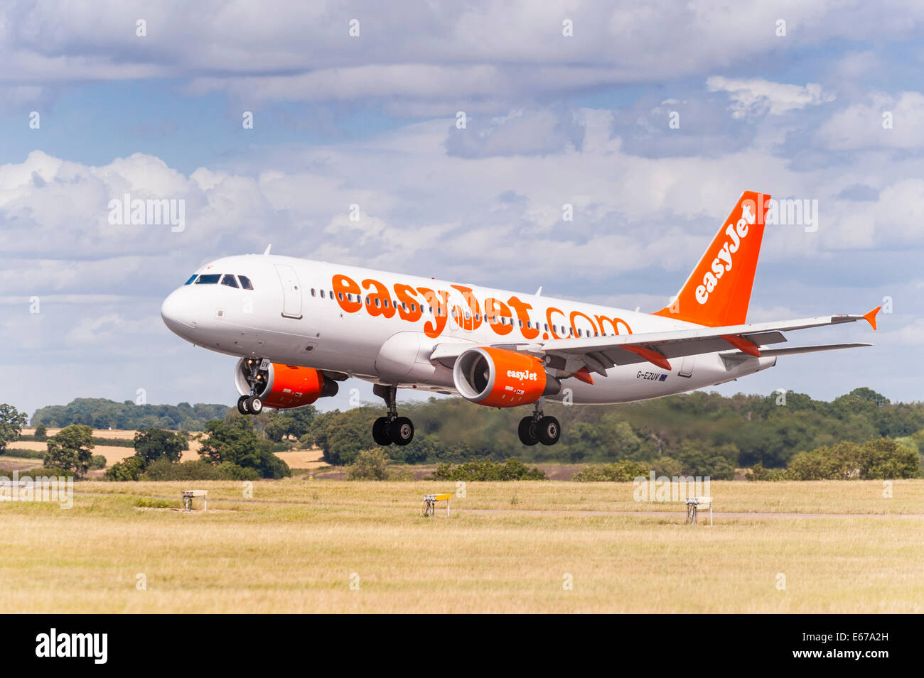 An easyJet Airbus A320 landing at Luton Airport in England , Britain , Uk - Stock Image