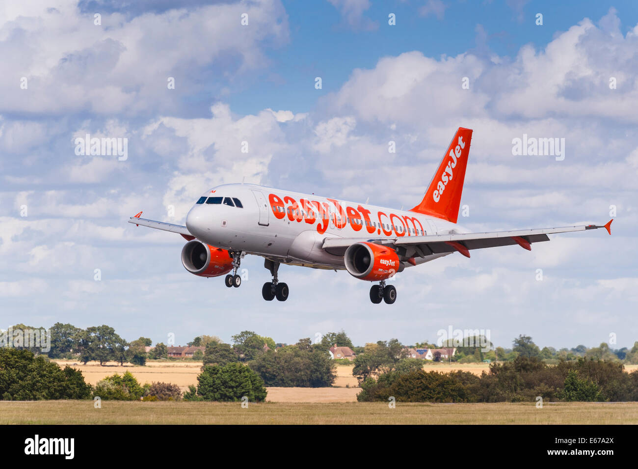 An easyJet Airbus A319 landing at Luton Airport in England , Britain , Uk - Stock Image