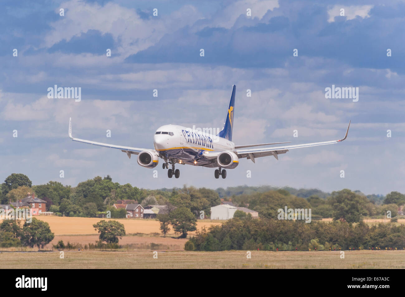 A Ryanair Boeing 737 coming in to land at Luton Airport in England , Britain , Uk - Stock Image