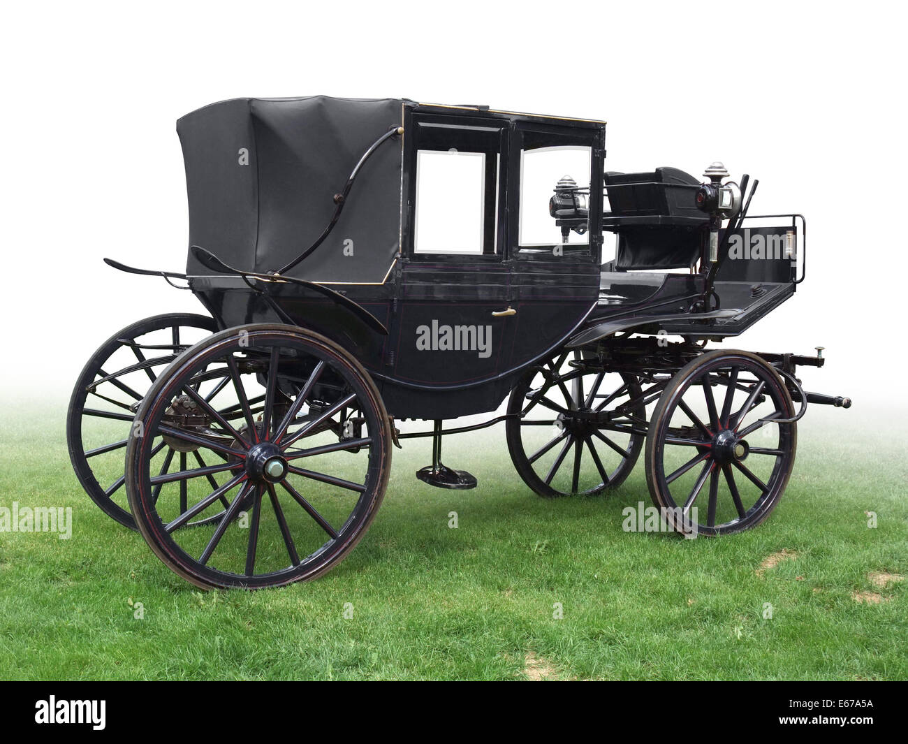 black historic carriage on green grass, gradient isolated on white Stock Photo