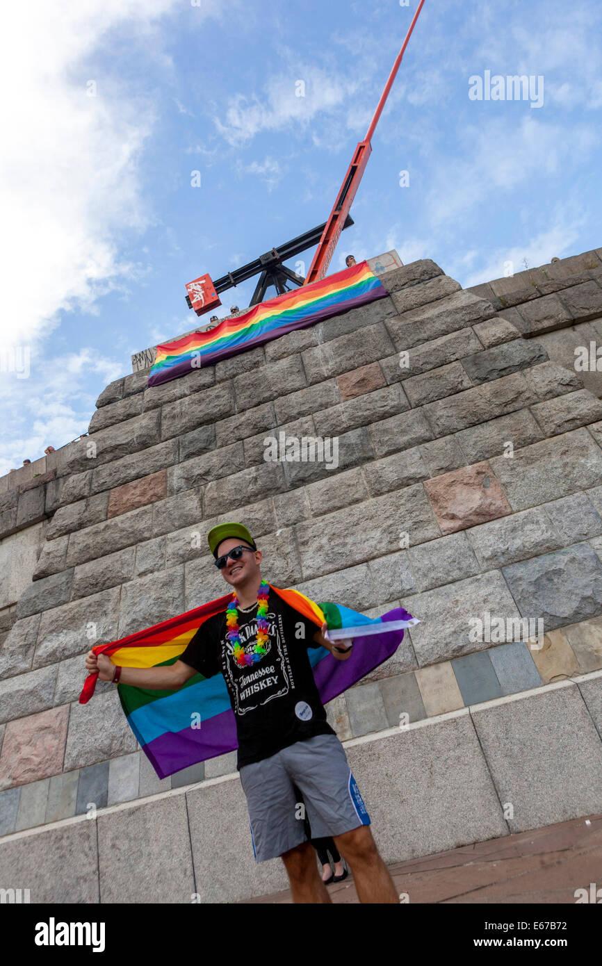 LGBT Prague pride. Man with flag bellow Prague Metronome, former Stalin monument place, Czech Republic - Stock Image