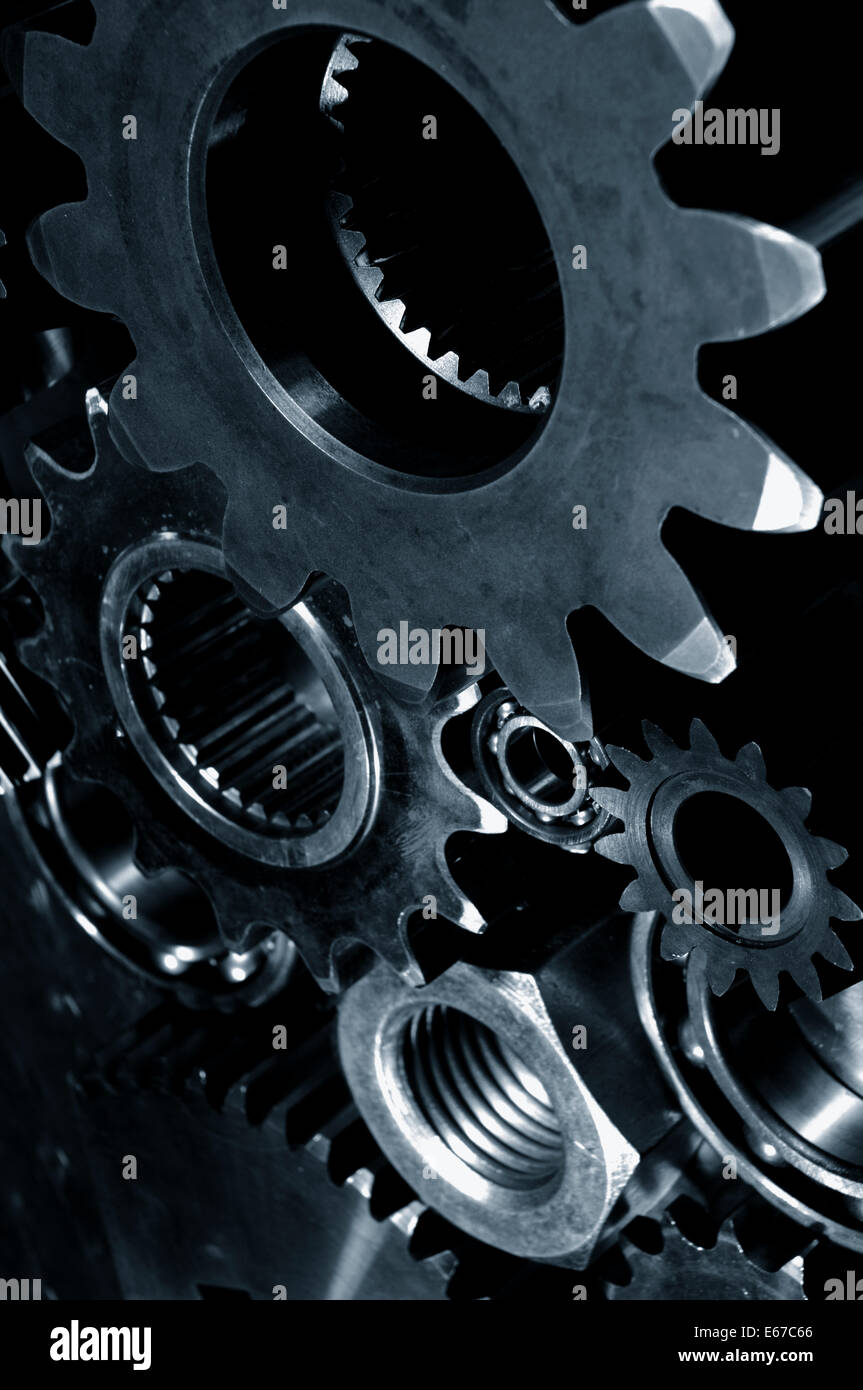 cogwheels and gears in deep blue toning - Stock Image