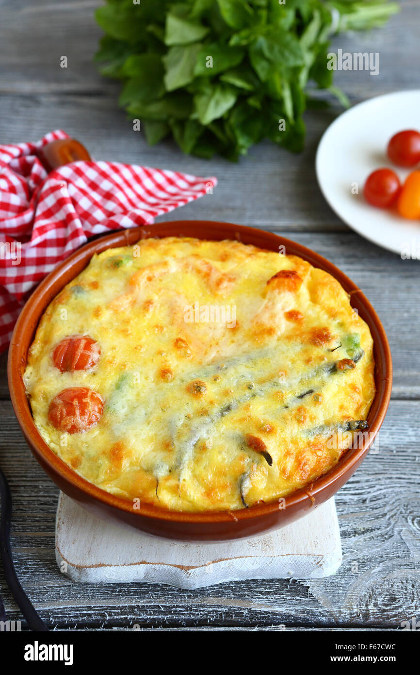 Frittata with tomatoes and green beans, food closeup - Stock Image