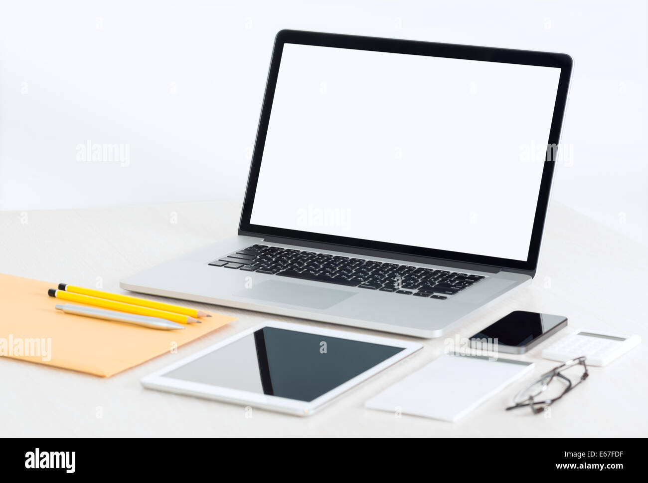 Modern office workplace with metallic laptop, digital tablet, mobile phone, papers, notepad and others business Stock Photo