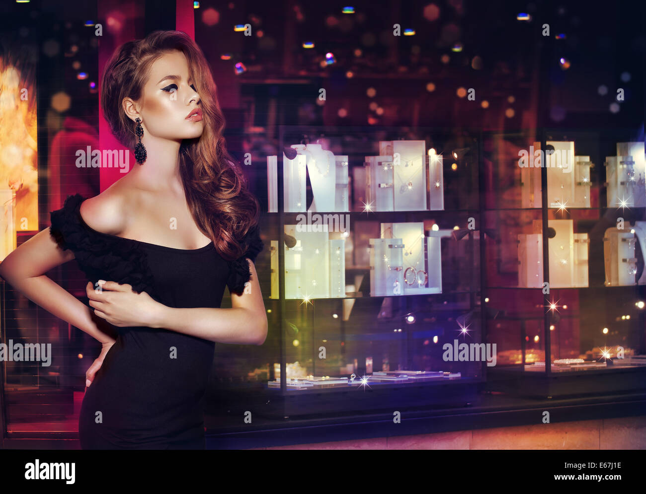 Fantasy. Beautiful Lady over Shop Window with Jewels - Stock Image