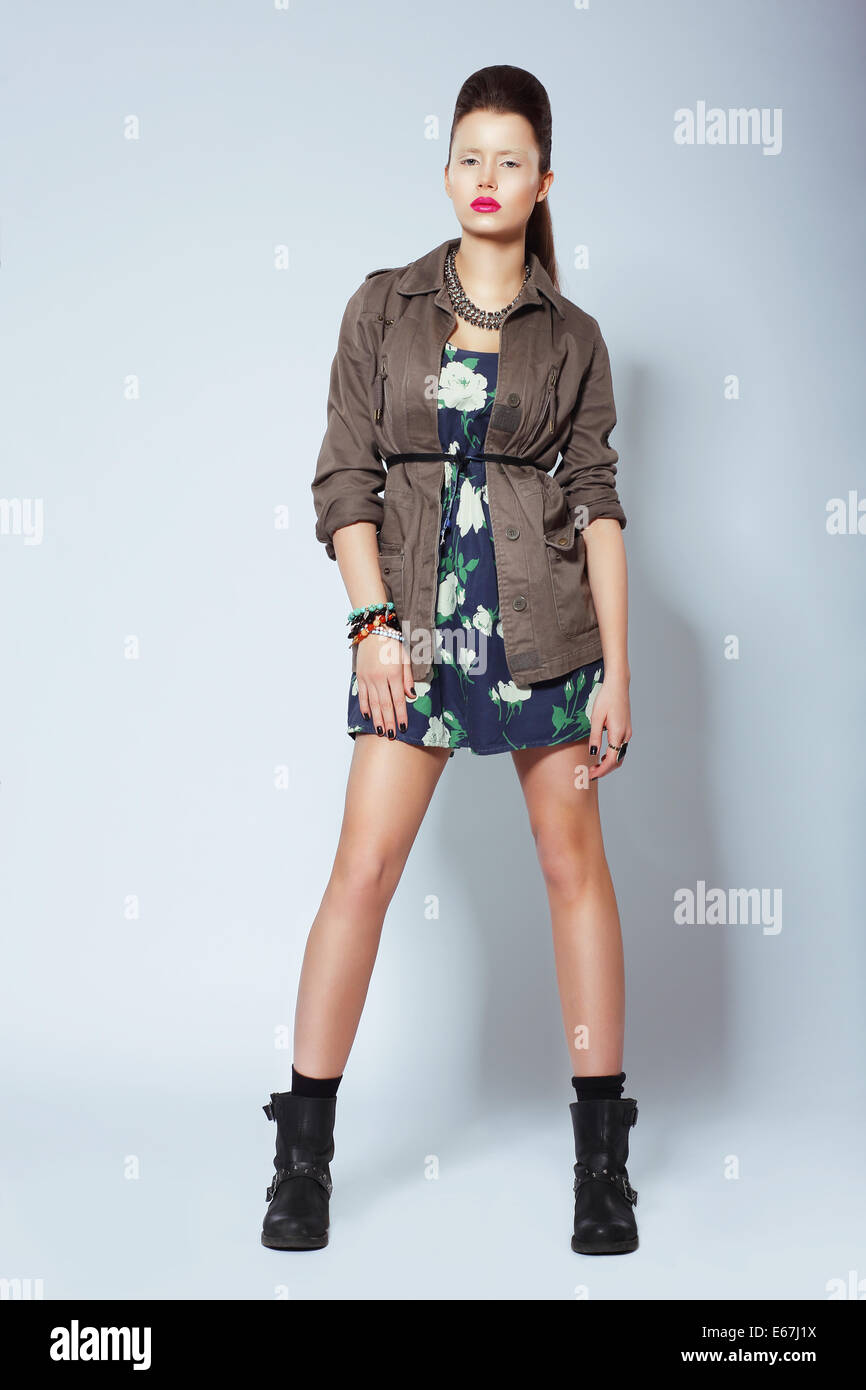 Full Length of Elegant Woman in Boots and Trendy Clothes - Stock Image