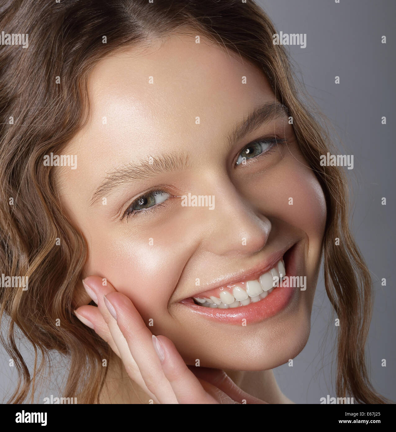 Sincere Winning Smile. Face of Happy Pleasant Young Woman - Stock Image