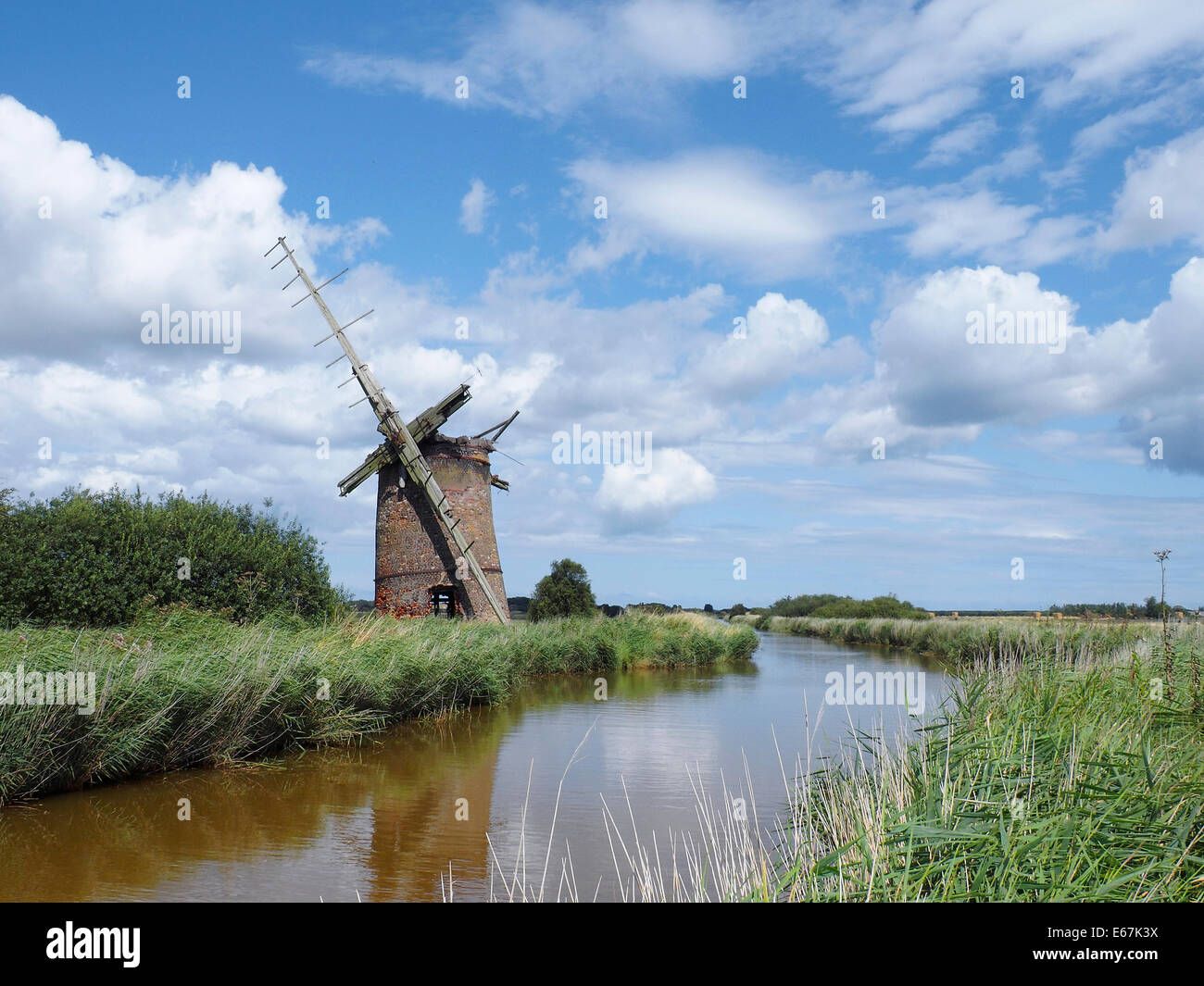 Brograve drainage windmill Norfolk Broads on the New Cut from Horsey Mere near Sea Palling grade II listed building - Stock Image