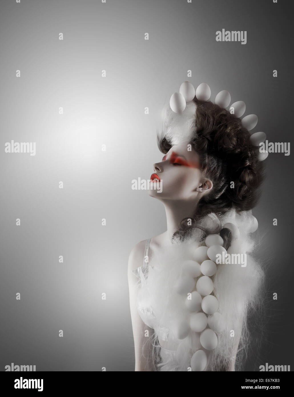 Creative Concept. Styled Futuristic Woman with Fantastic Headwear - Stock Image