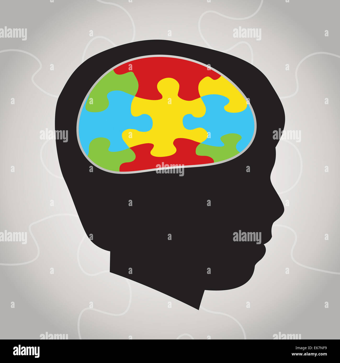A silhouette of a child with symbolic autism puzzle pieces making the brain space. - Stock Image
