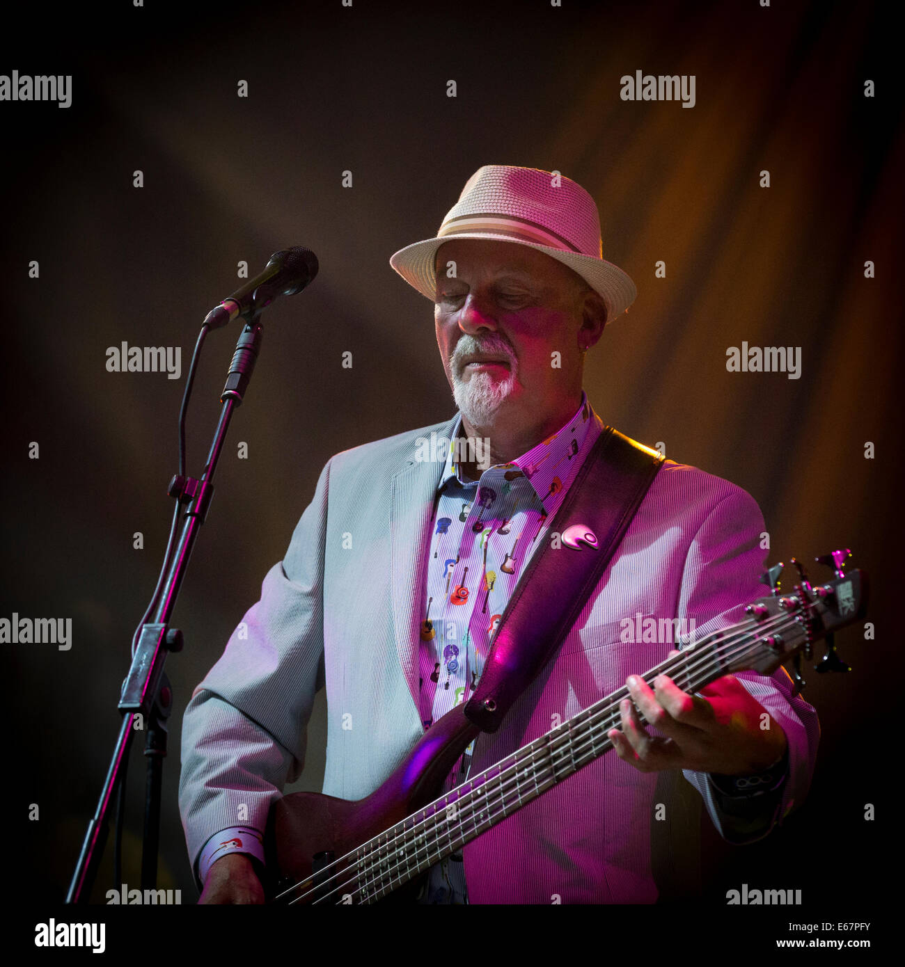 Dave Pegg of Fairport Convention playing a mondolin on stage at Fairport's Cropredy Convention 2014 - Stock Image