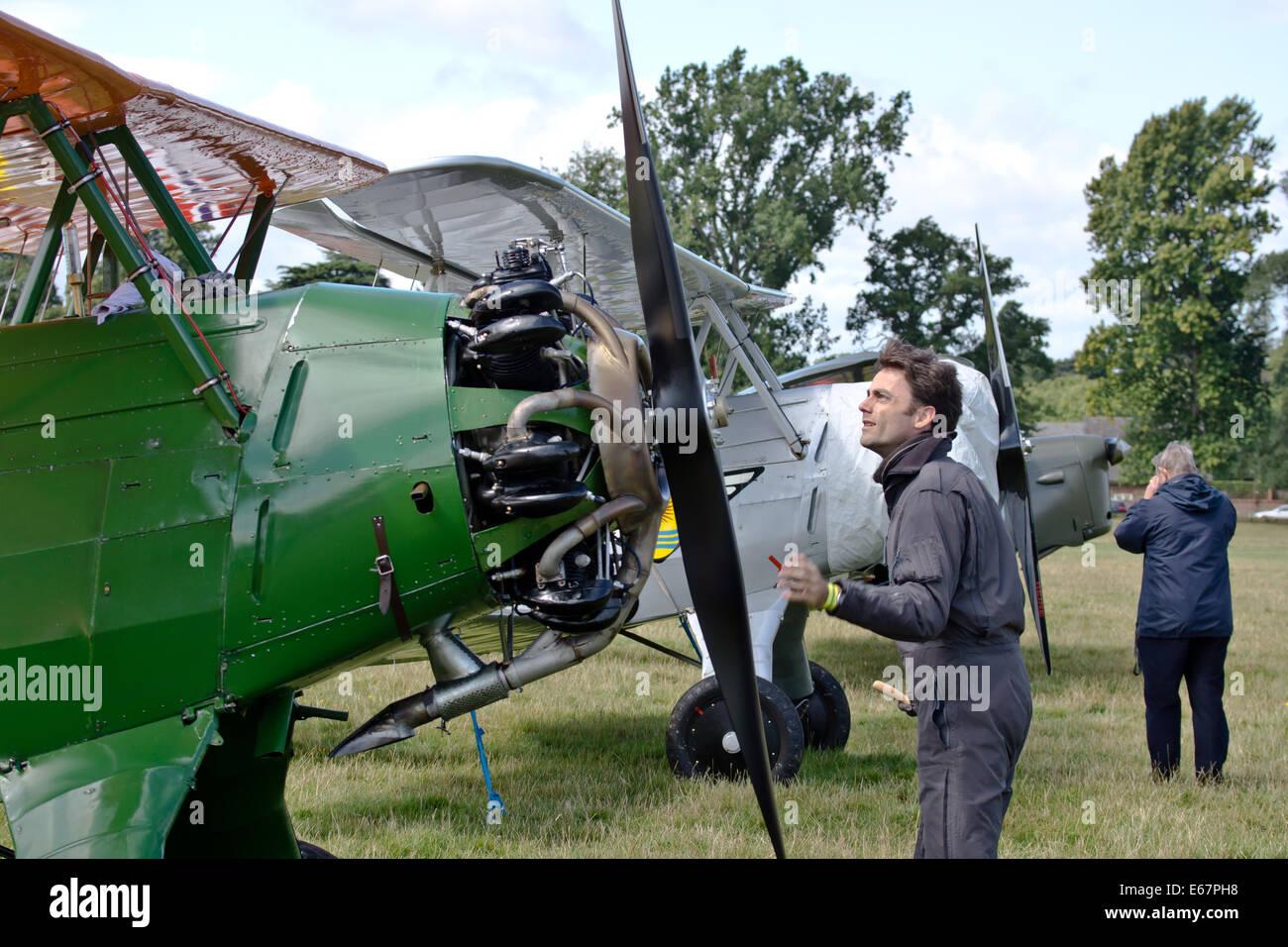 29th international Moth Rally at Woburn Abbey UK.The pilot of the Focke-Wulf Fw-44J Stieglitz prepares his plane. - Stock Image