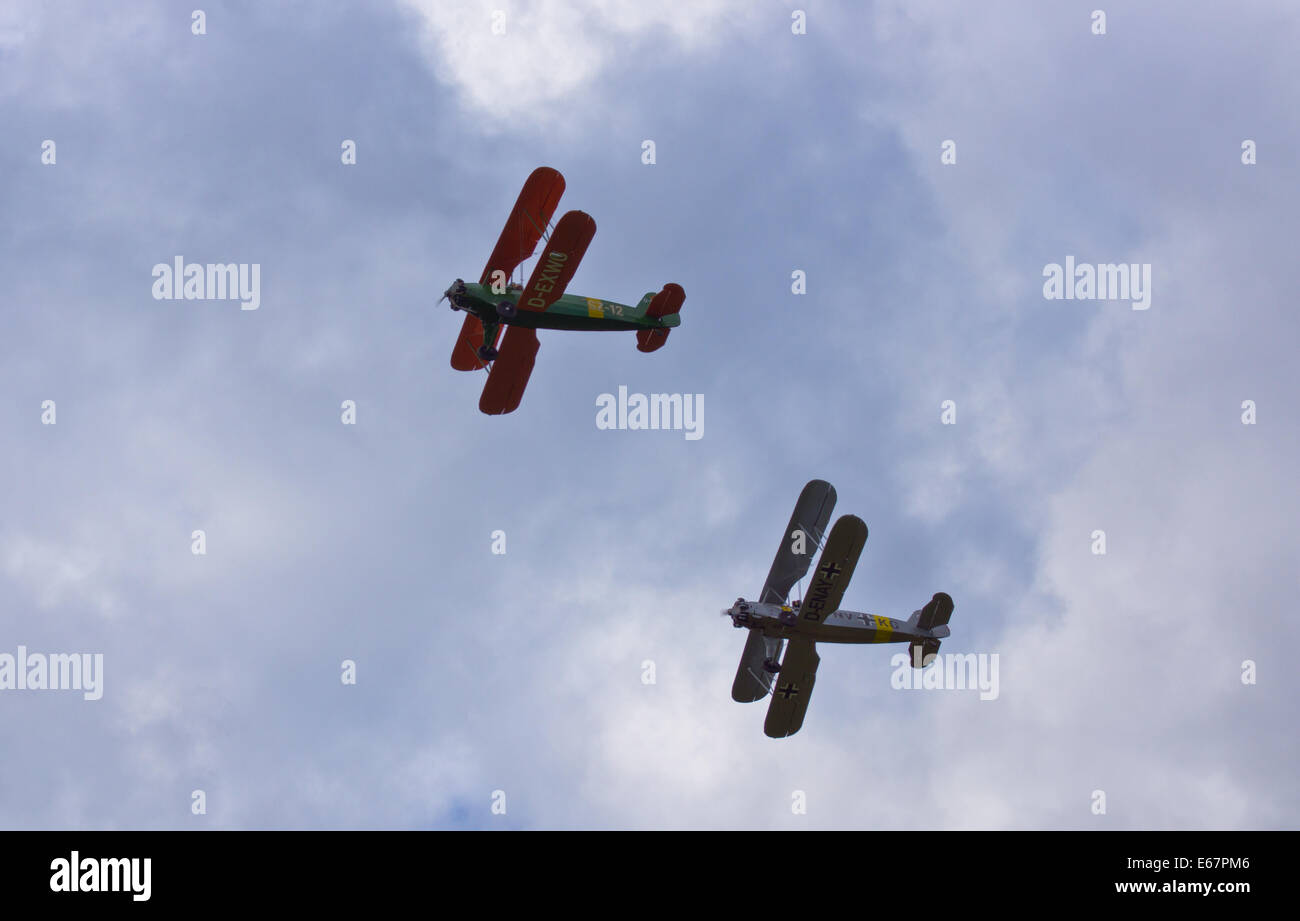 29th international Moth Rally at Woburn Abbey UK.Two  Focke-Wulf Fw 44 Stieglitz flyby before heading home. Credit: - Stock Image