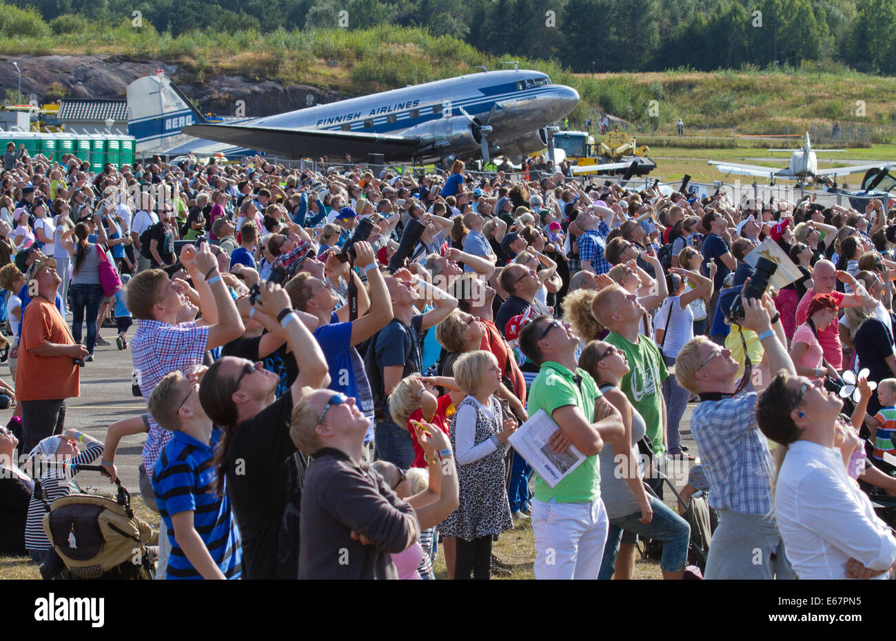 Helsinki, Finland, 17th of August, 2014. People watched Finland International Airshow 2014 at Helsinki-Malmi Airport. - Stock Image