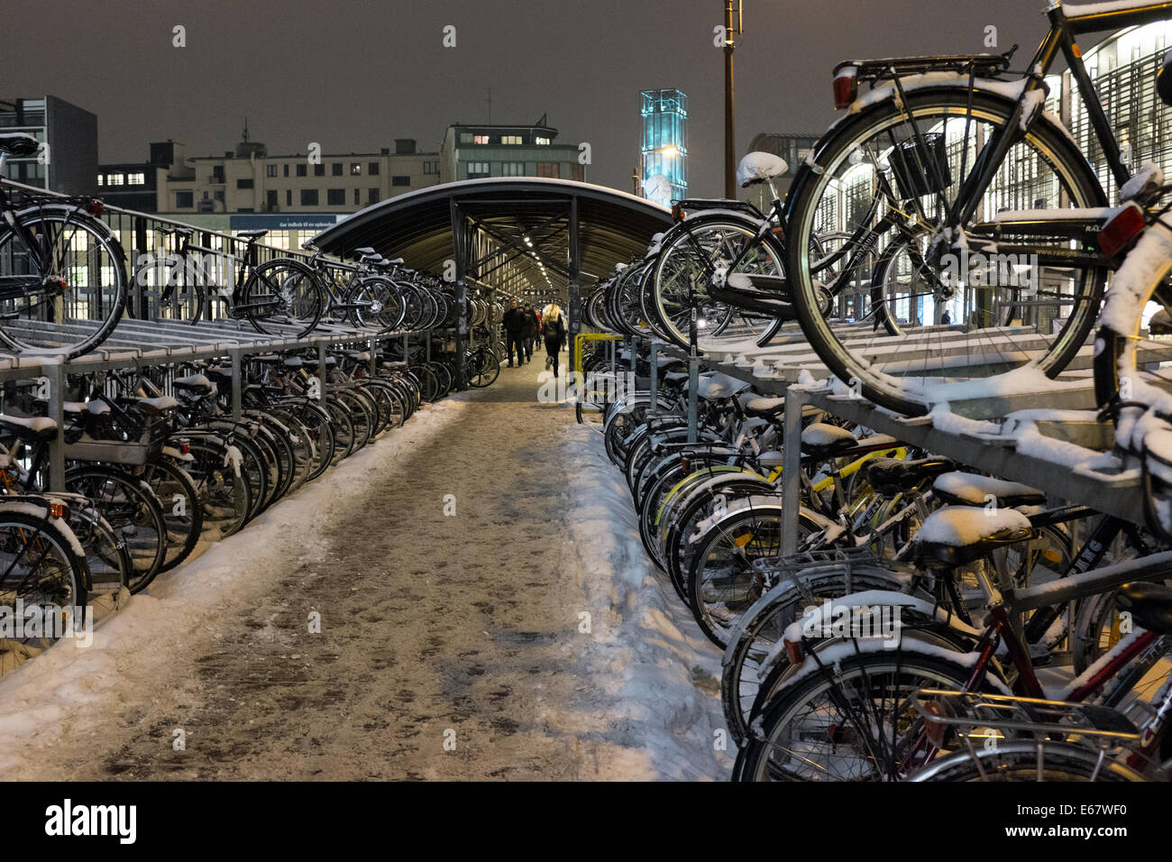 Bike parking in the train station over the train lines, in Aarhus, Denmark, Europe - Stock Image