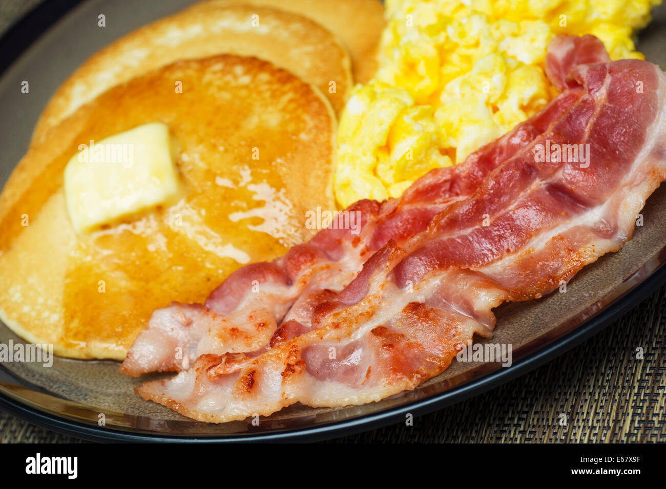 Eggs Bacon Pancakes and Scrambled Eggs Breakfast - Stock Image