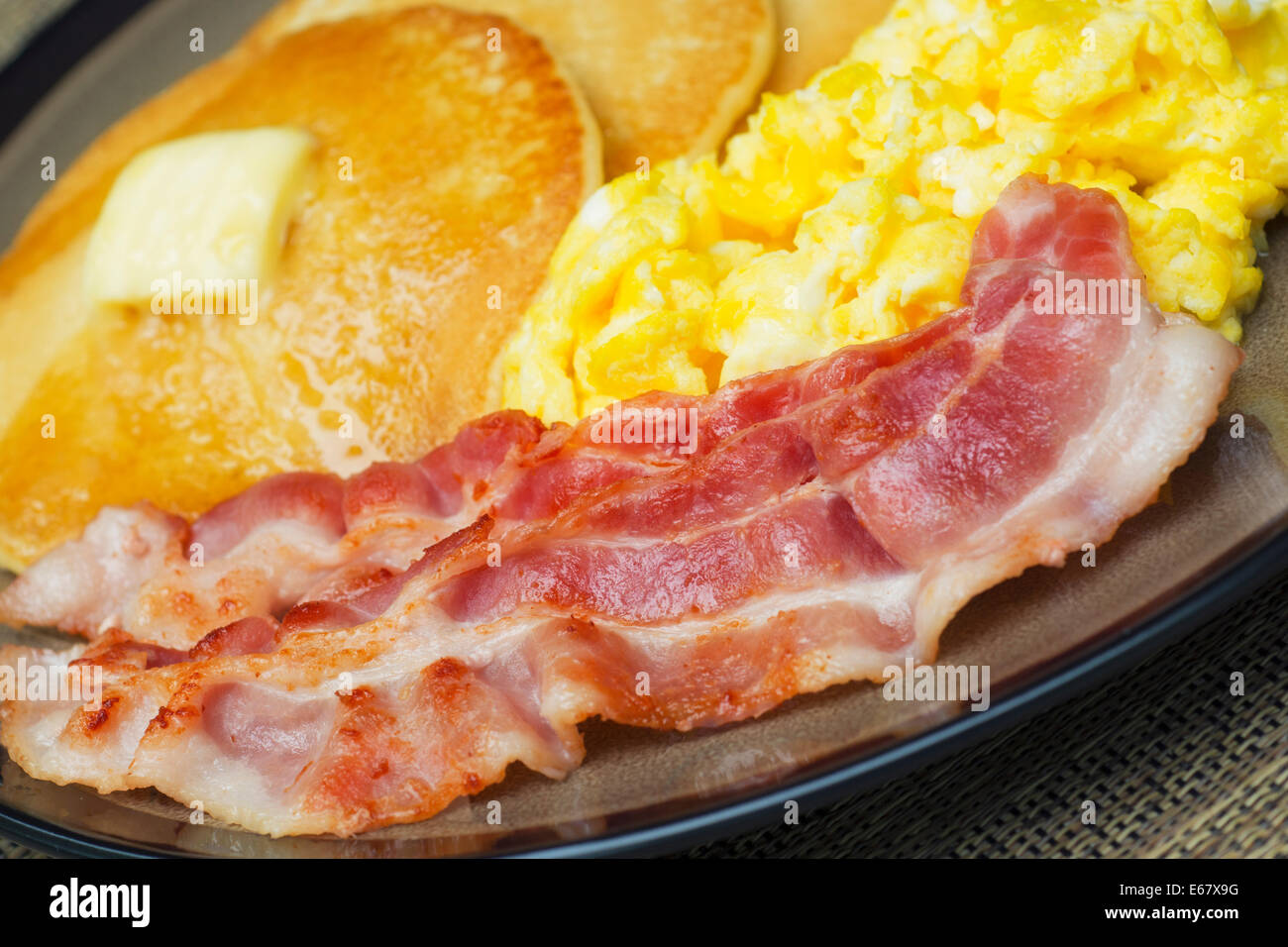 Eggs and Bacon, Scrambled Eggs and Pancakes, Pancake Breakfast - Stock Image