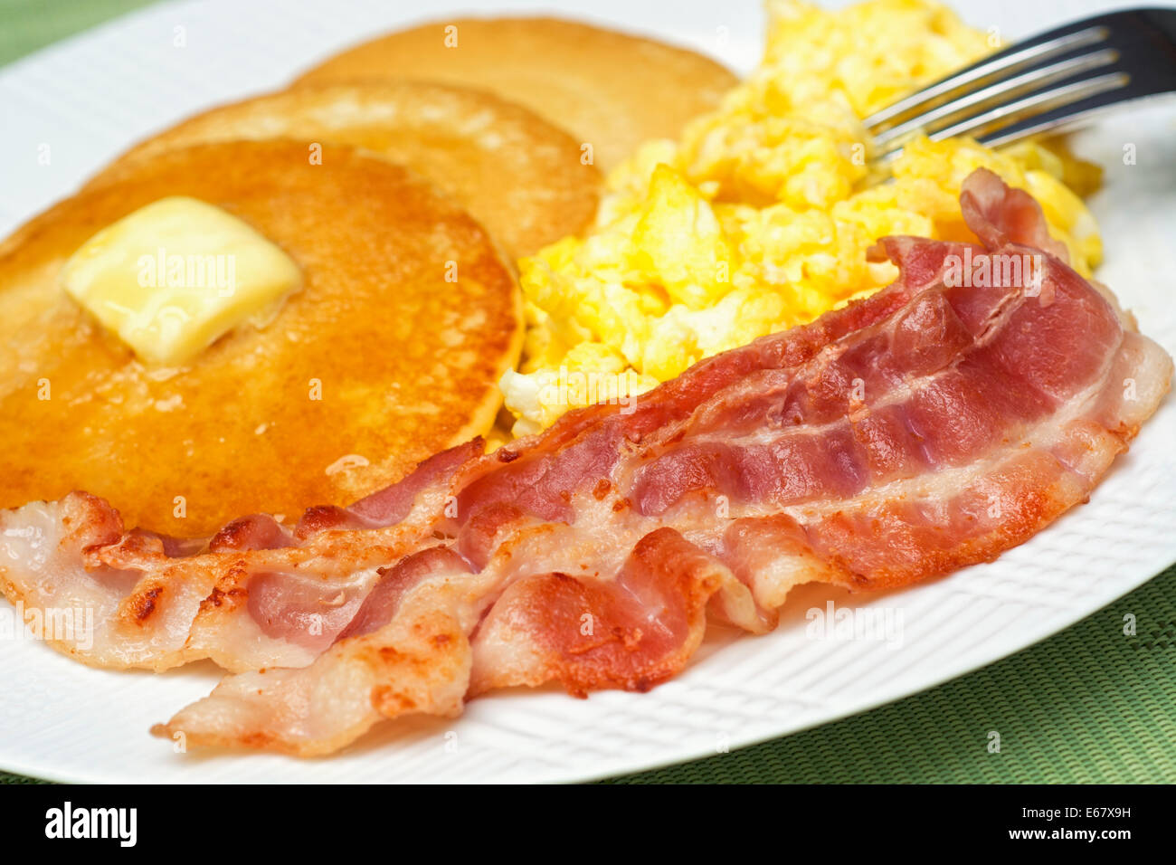 Eggs Bacon and Pancakes, Scrambled Eggs and Pancake Breakfast - Stock Image