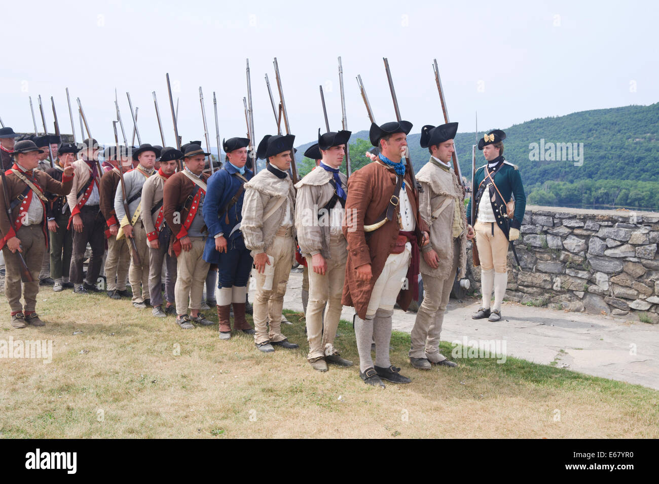American Revolutionary war soldiers (reenactors) lined up to march after inspections by superior officers. - Stock Image