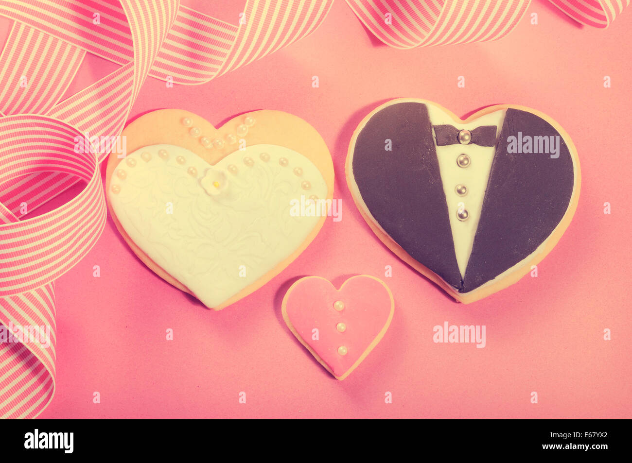 Delicious wedding party bride and groom pink, white and black heart ...