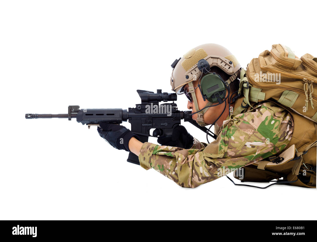 soldier holding rifle or sniper lying on the floor - Stock Image