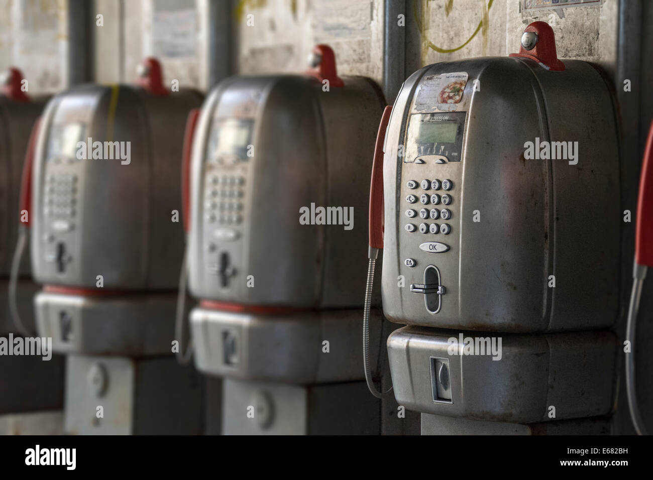 Line of old style pay phones located next to San Marco Square in Venice. Right to left orientation. - Stock Image