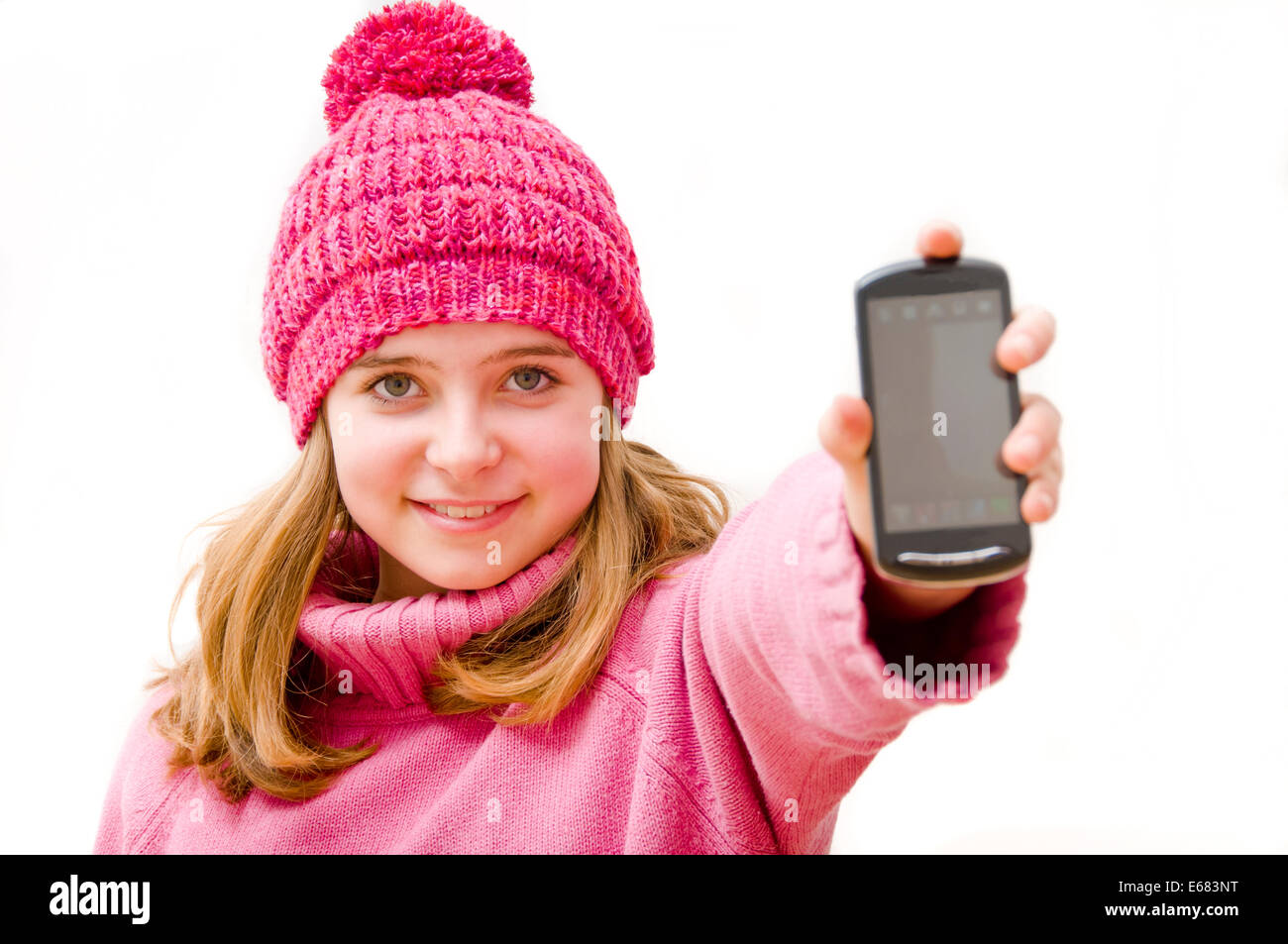 girl showing her cellphone - Stock Image