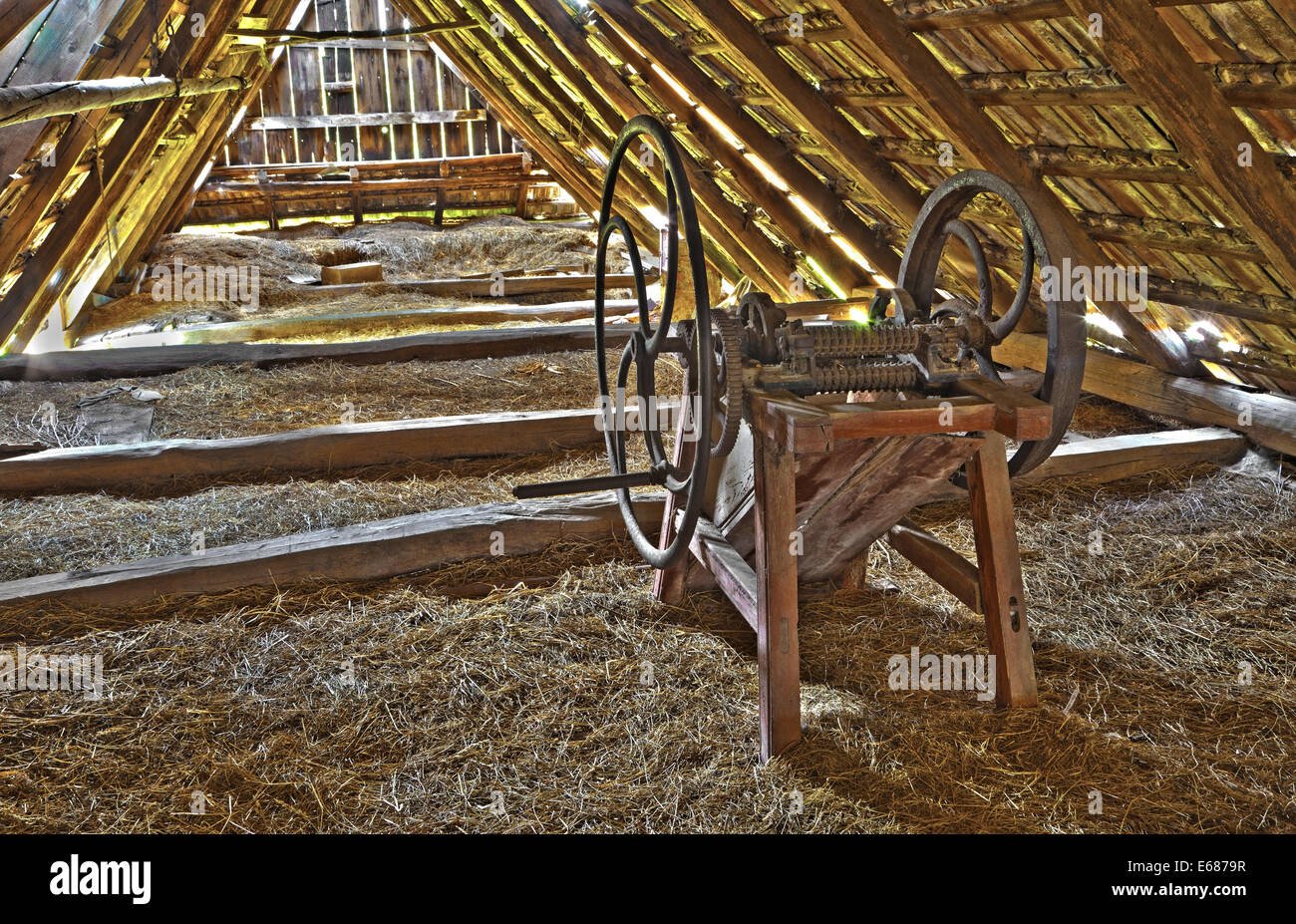 old chaff machine on the billet of village house in Slovakia - Stock Image