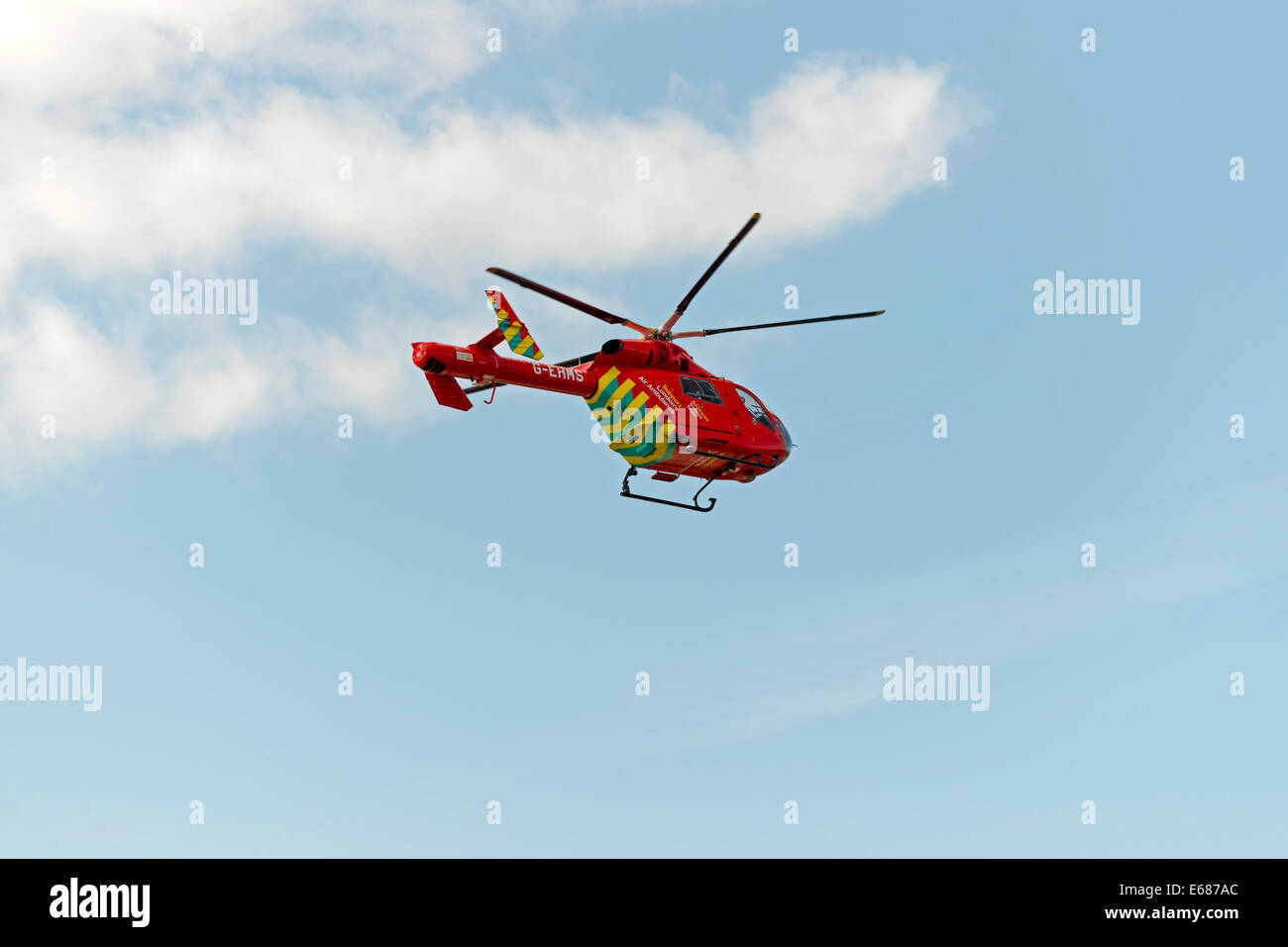London Red Air Ambulance Helicopter in Flight - Stock Image