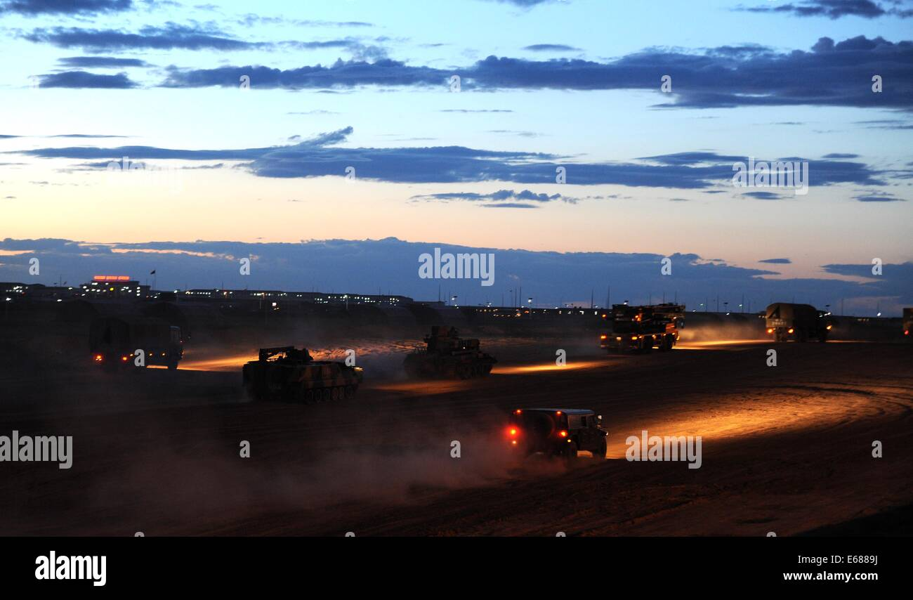(140818) -- ZHURIH, Aug. 18, 2014 (Xinhua) -- Armoured equipment of foreign troops are seen at the Zhurihe training - Stock Image