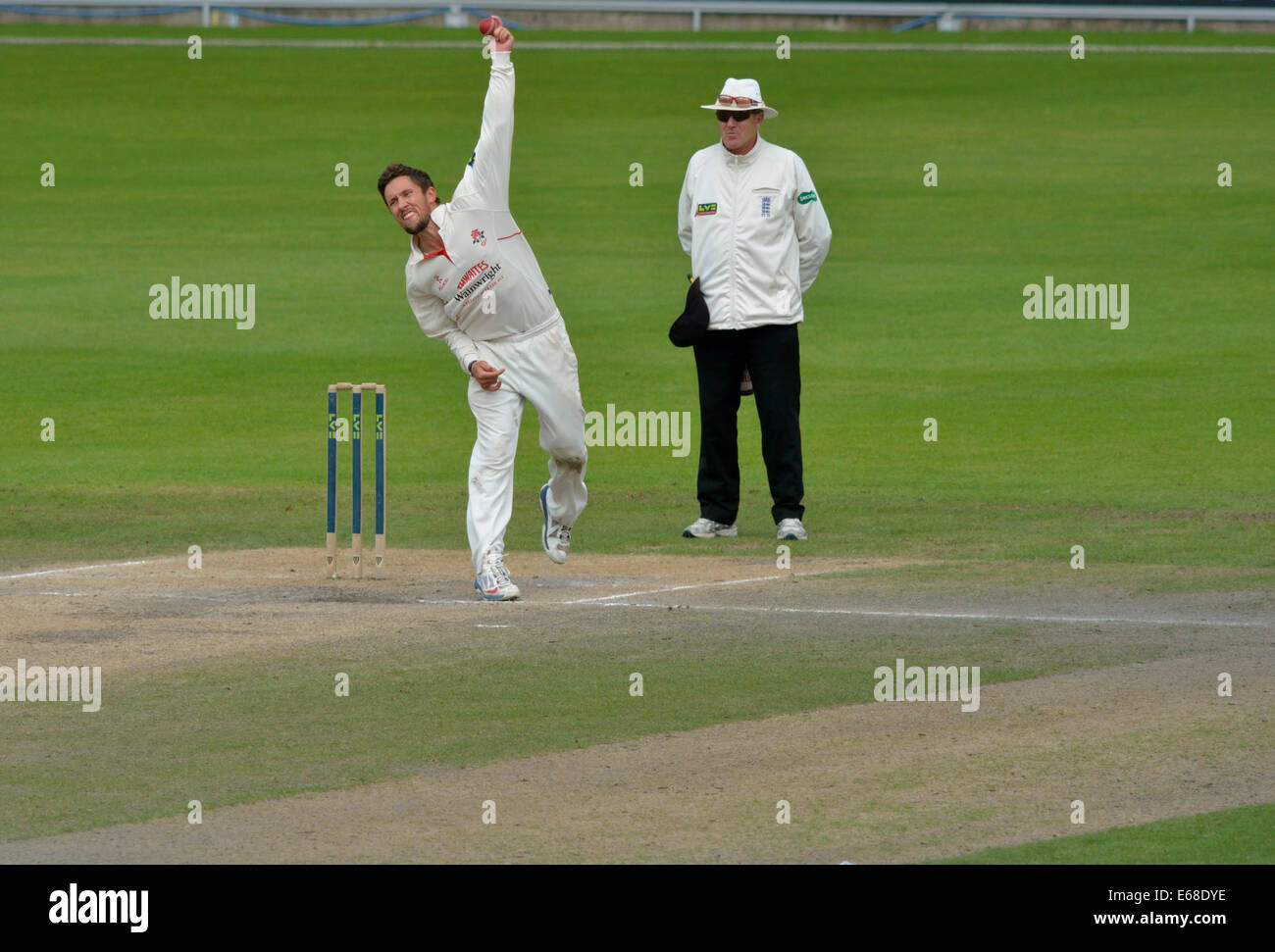 Emirates Old Trafford, Manchester, UK 18th August 2014 Simon Kerrigan (Lancashire) in action on the final day when - Stock Image