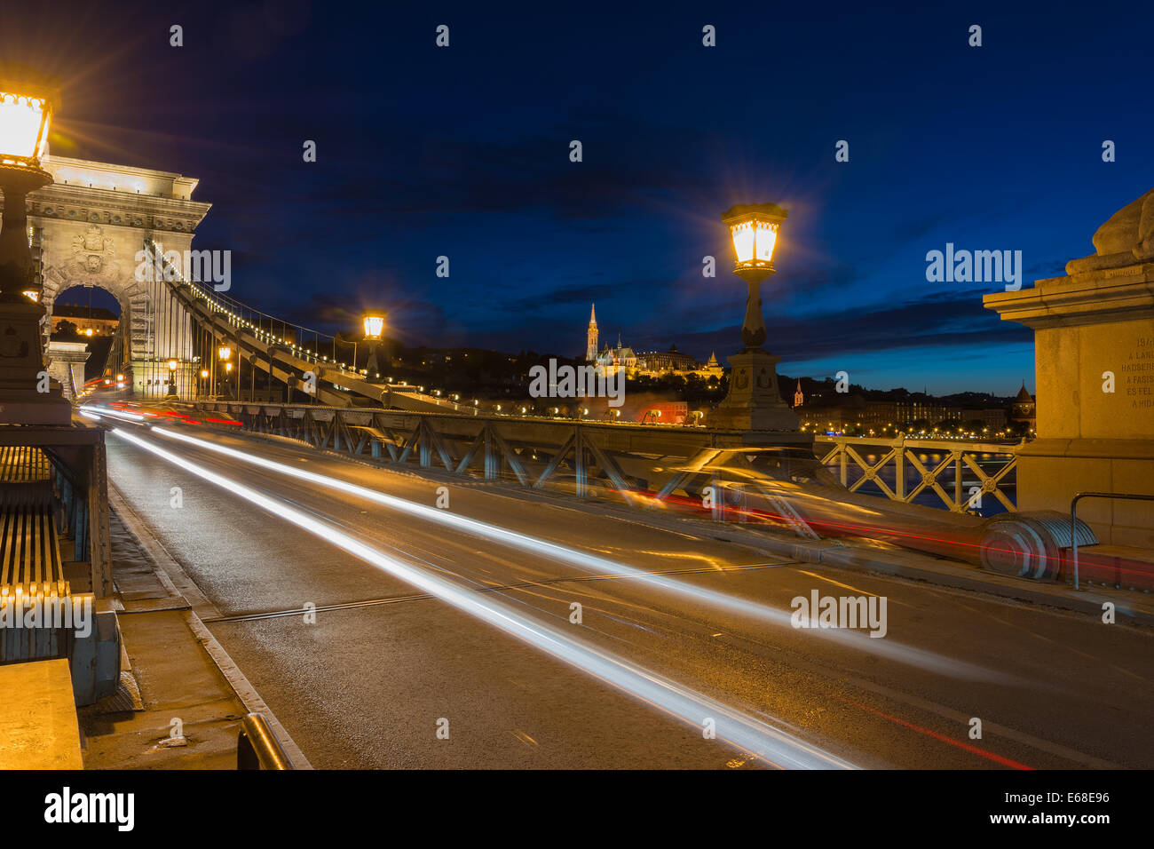 View of Fisherman's Bastion and Matthias church from chain bridge Budapest - Stock Image