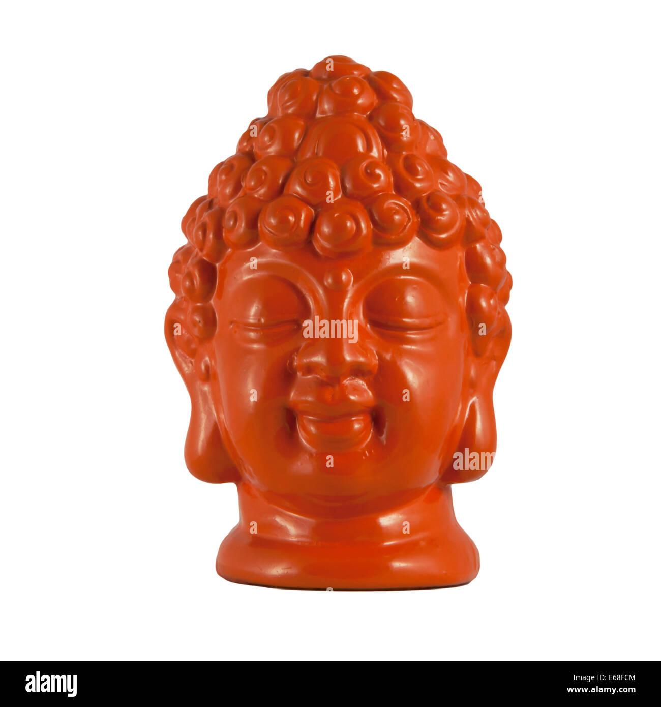 Orange clay head of Buddha isolated on white - Stock Image