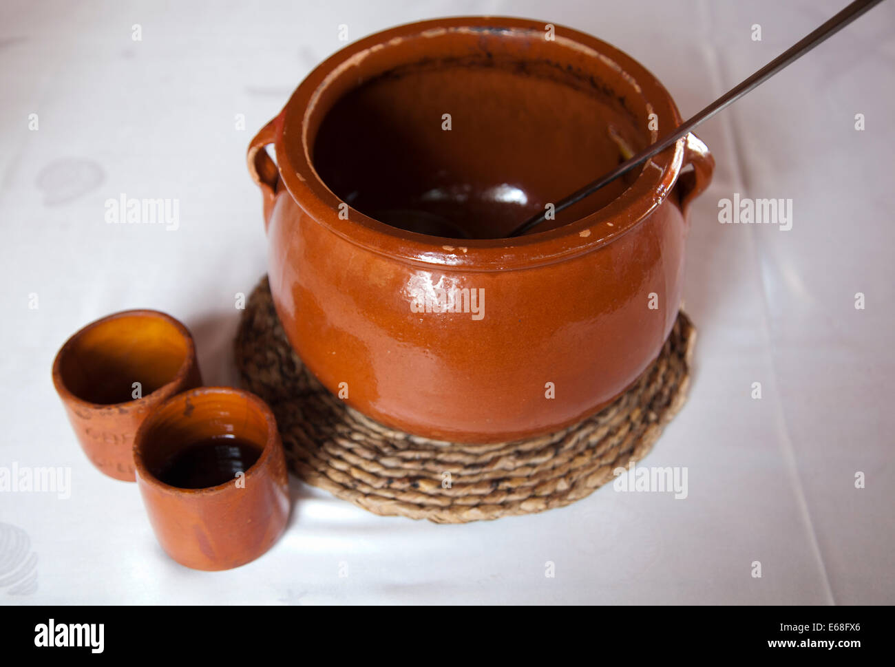 Sa Caleta Beach Restaurant Serve their unique Alcoholic Coffee from Clay Jug  in Ibiza - Stock Image