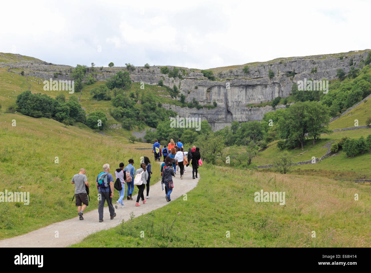 Walking in the Yorkshire Dales National Park at Malham Cove Yorkshire England UK - Stock Image