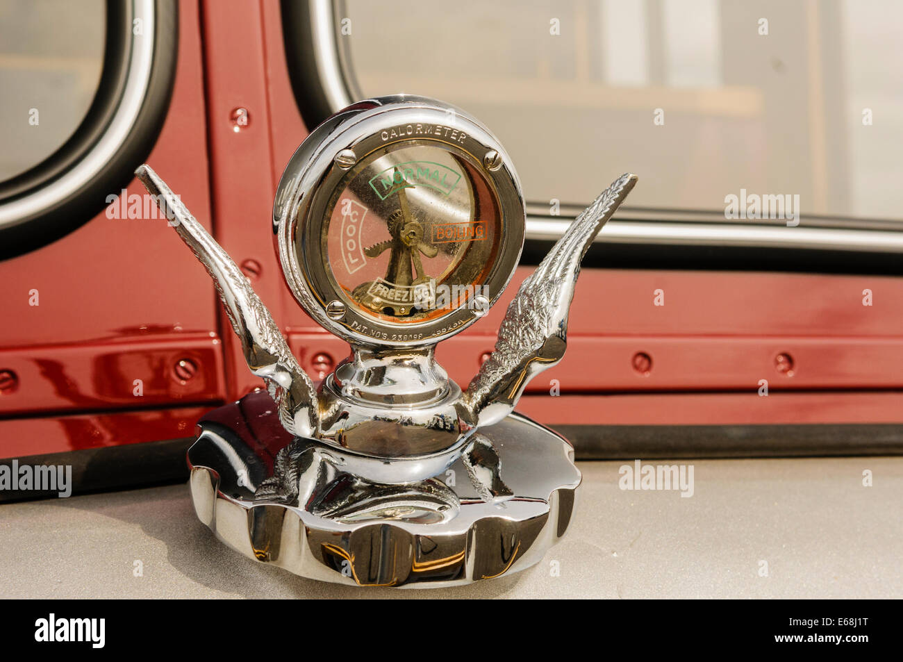Engine temperature gauge on the front of an old lorry - Stock Image