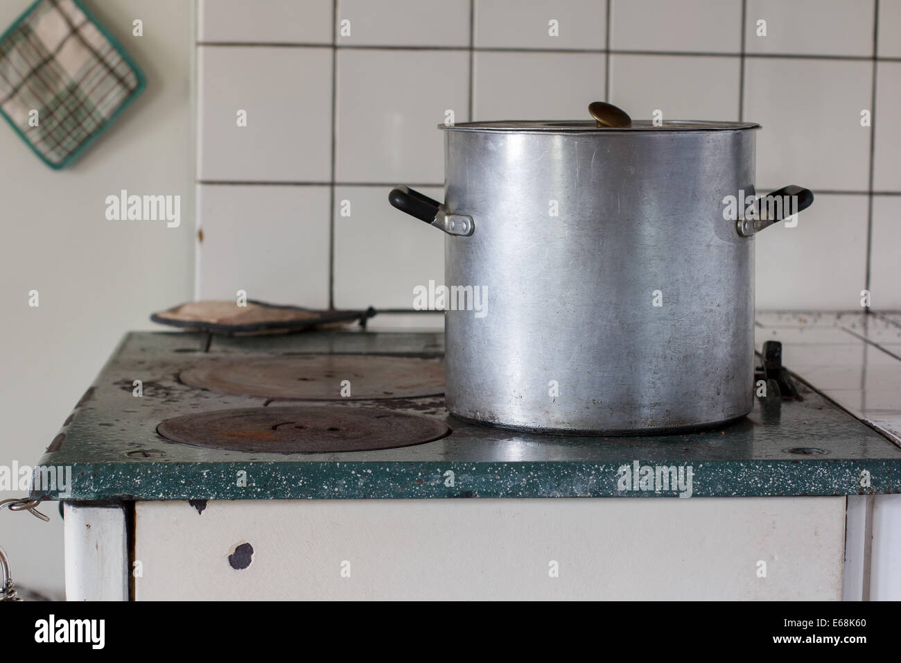 Old stove with a pot on it - Stock Image