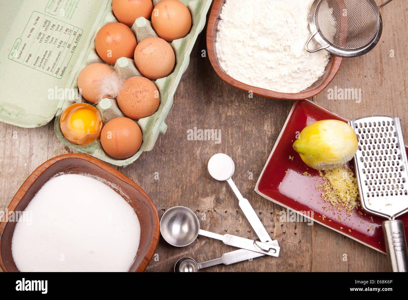 sponge cake ingredients eggs sugar flour lemon baking powder - Stock Image