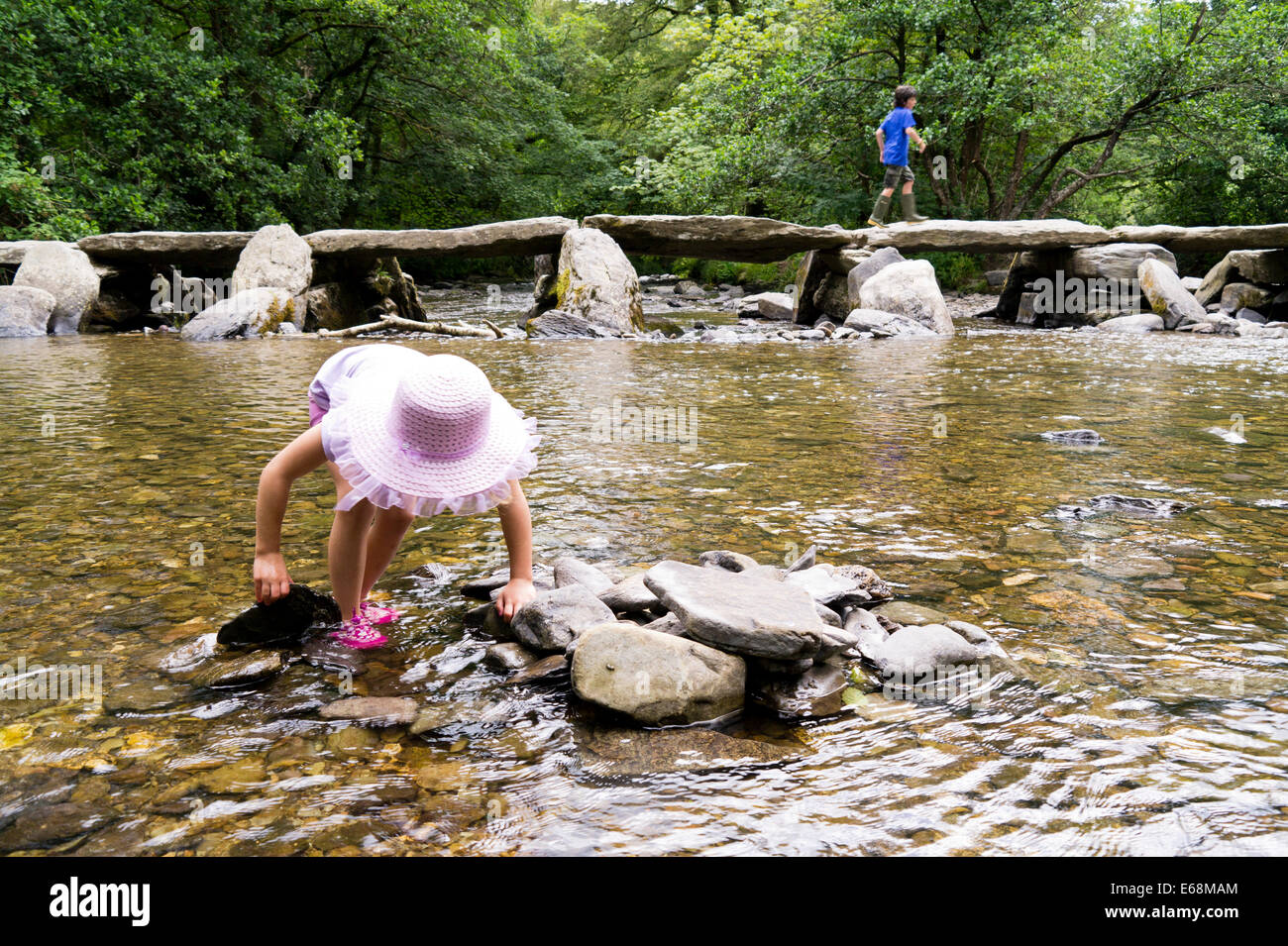 Young child exploring Tar Steps Exmoor - Stock Image