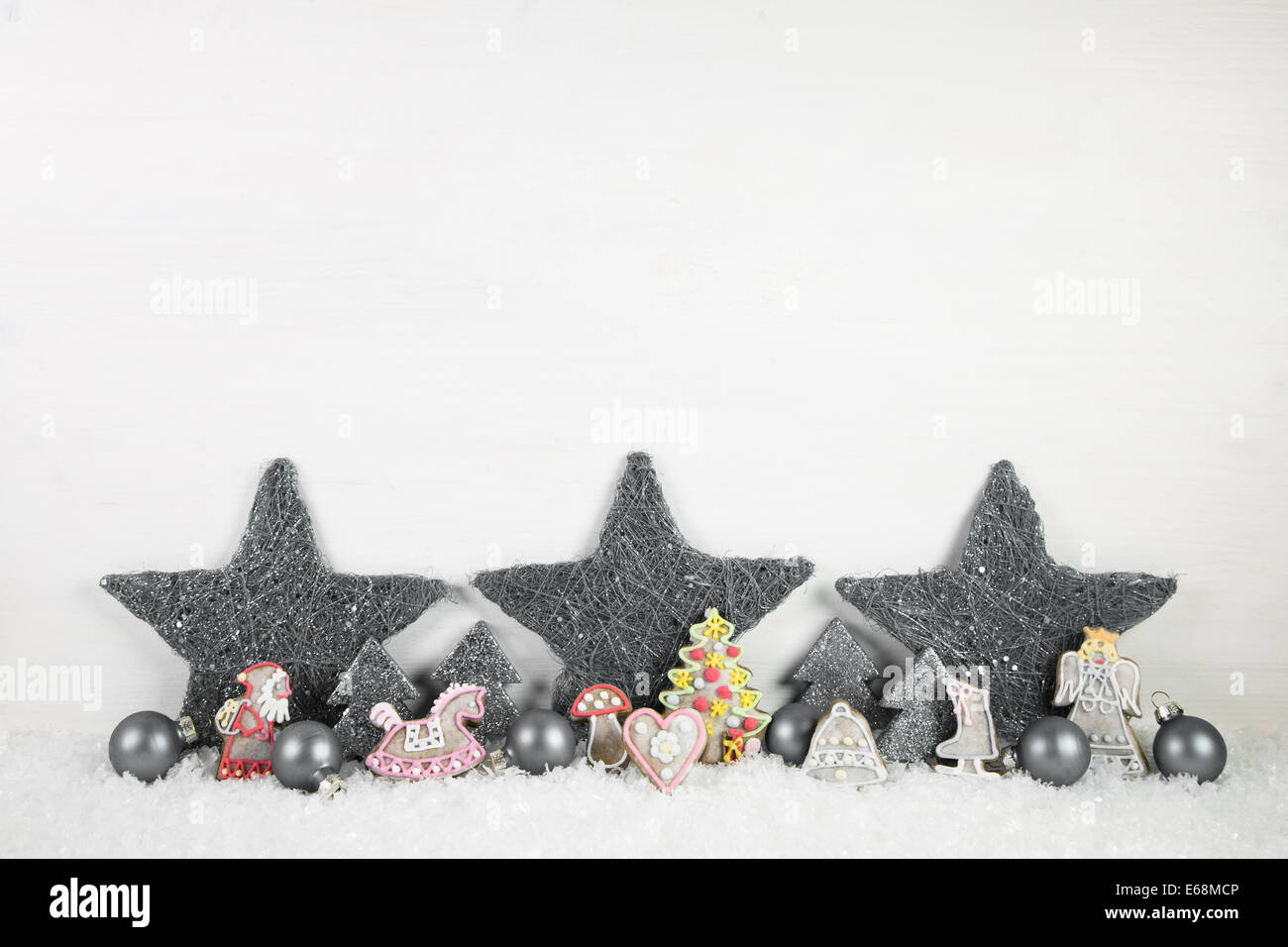 Shabby chic wooden christmas background in white and grey for decorations. - Stock Image