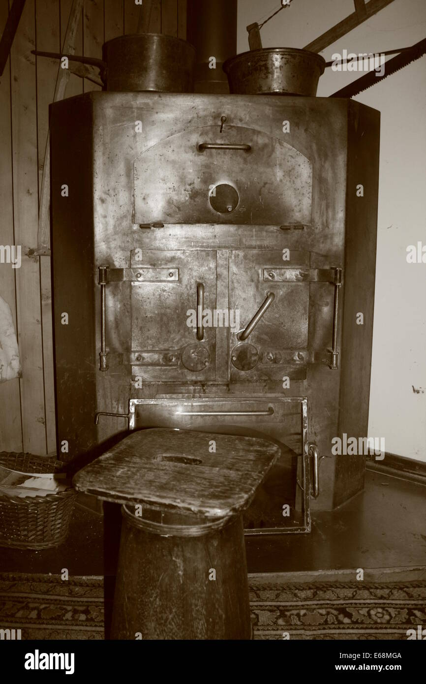 Old fashioned burner, boiler and stove or oven - Stock Image