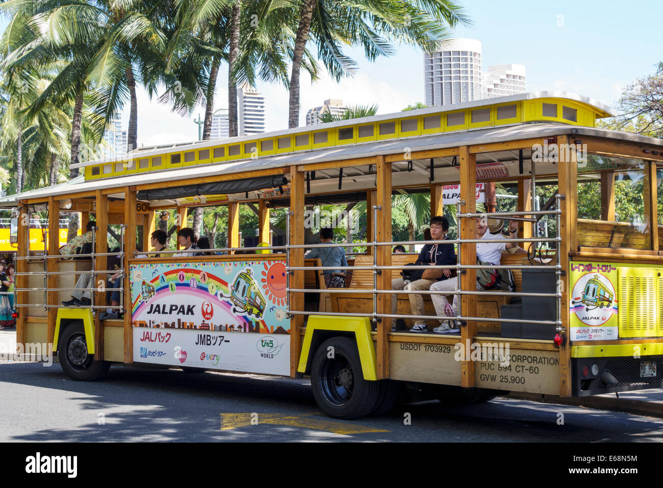Hawaii Hawaiian Honolulu Ala Moana Center mall shopping Jalpak Trolley Japanese tourists riding transportation Stock Photo