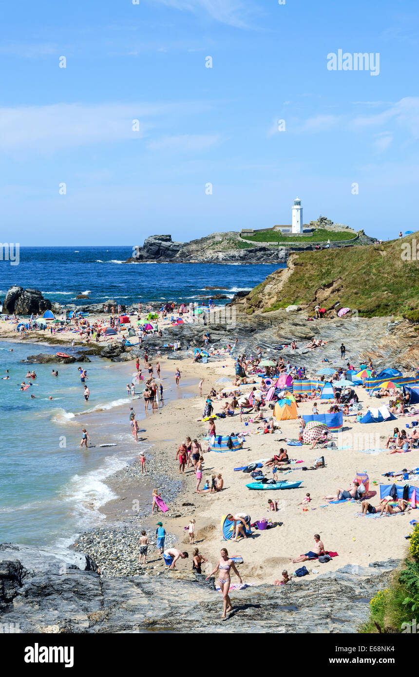 Families enjoying the sunny weather at Godrevy beach near Hayle in Cornwall, UK - Stock Image